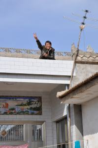 Jason's eldest brother on the roof of his family's home.