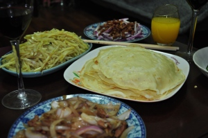 Jason made 煎饼, a crepe-like pancake which you fill with dishes such as julienned potatoes and pork & onions in a brown sauce (both pictured).