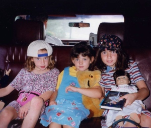 Gangsta girls in their ride, with a doll
